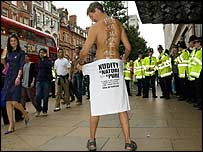 One of the naked protesters, who has his short on in this picture