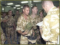 British soldiers from the 2nd Battalion Light Infantry prepare to depart from Cyprus for Iraq