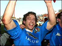 Italian fly-half Diego Dominguez celebrates his team's win over Wales at the start of the Six Nations championships