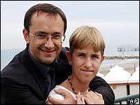 Russian director Andrey Zvyagintsev (left) hugs actor Ivan Dobronravov