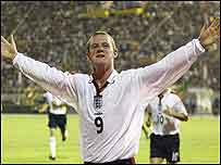 Wayne Rooney celebrates his equaliser against Macedonia