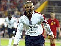 Beckham celebrates his winning penalty in Skopje
