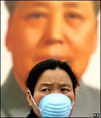Chinese woman in mask, AP