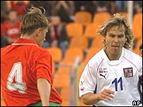 Belarus' Aleksander Lukhvich takes on Pacel Nedved of the Czech Republic