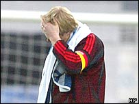 Germany's captain Oliver Kahn leaves the pitch after his side's 0-0 draw in Reykjavik