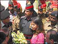 Pakistani rangers (grey uniforms) and Indian BSF soldiers get their photographs taken with Bollywood actress Urmila Matondkar