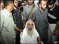 Sheikh Yassin surrounded by bodyguards in a mosque after the attack