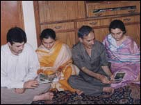 Nazir Ahmed Wani with his three children