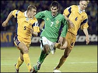 Andriy Nesmachniy and Oleksandr Horshkov of Ukraine in action against NI's Keith Gillespie
