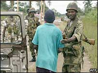 Ecomil soldiers check Liberians moving from rebel-held areas to Monrovia