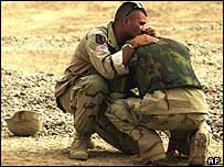 A US soldier in Iraq consoles his colleague following an attack