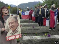 Supporters of Augusto Pinochet sing near a monument in honour of five of his bodyguards who died in an unsuccessful 1986 attempt on his life
