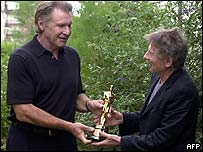 Harrison Ford presenting Roman Polanski with Oscar at Deauville