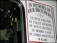 The names of those killed in the World Trade Center are painted on the side of engines