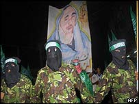 Hamas militants carrying a poster of the sheikh