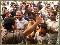 Iraqis celebrate on the streets of Basra on hearing  that Baghdad has fallen