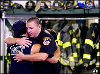 Firefighters console each other in the aftermath of 11 September