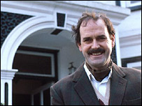 John Cleese as Basil Fawlty