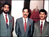 Saddam Hussein (centre) with Uday (left) and Qusay (right)