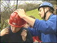 Teacher helping pupil with safety