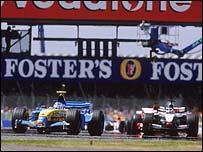 Jarno Trulli leads the field at the start of the British Grand Prix