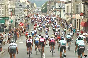 The peloton ride through the streets of Pau in the early part of the stage