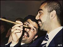 Qusay (left) and Uday Hussein