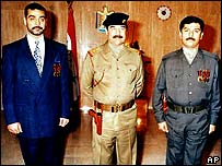 Saddam Hussein (Centre) with sons Uday (Left) and Qusay