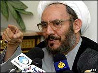 Iran's Intelligence Minister Ali Yunesi speaks to reporters during a news conference in Tehran, 23 July 2003