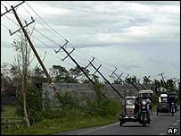 Battered telegraph poles in Isabela province, northern Philippines