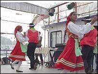 Dancing the Corredinho on a tourist boat