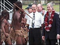 Nick Warner being greeted by a group of tribal dancers