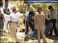 Investigators at the site where the women were found