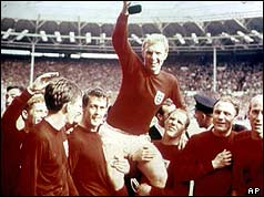 Captain Bobby Moore holds the trophy aloft