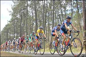 The pack, with overall leader Lance Armstrong (fourth from right) rides through a pine forest outside Rion-des-Landes