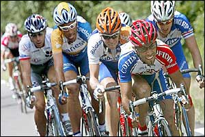 Frenchman Mederic Clain leads the breakaway, followed by Frenchman Christophe Mengin