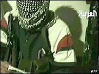 Masked man vows to avenge the death of Saddam Hussein's sons in a video sent to al-Arabiya