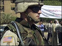 A US soldier keeps watch, as members of Ghreir tribe from Hillah, 80 kms south of Baghdad, demand the release of their leaders