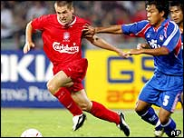 Michael Owen takes on the Thailand defence