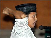 Abdul Aziz, aka Imam Samudra, punches the air in court