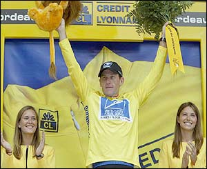 Lance Armstrong celebrates on the podium