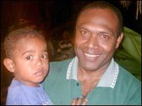 Eddie Sikua and his son