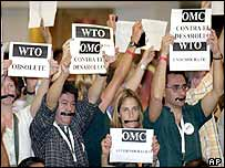 Demonstrators protest during the inauguration ceremony of the WTO meeting
