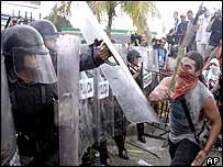 Demonstrators attack Mexican riot police protecting the World Trade Organization meeting in Cancun