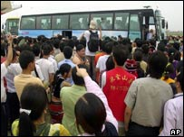 Fans surround a bus carrying David Beckham and his new team, Real Madrid