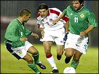 NI's David Healy (left) and Tommy Doherty go on the attack against Armenia