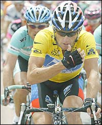 Lance Armstrong gestures as he rides, closely followed by Jan Ullrich of Germany