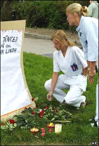Nurses put down flowers following the death of Swedish politician Anna Lindh