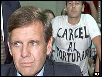 Argentine Captain Alfredo Astiz with protester behind (2000)
