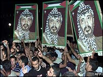 Palestinian supporters hold up pictures of Yasser Arafat in Gaza